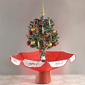 large-snowing-christmas-tree-with-umbrella~242225